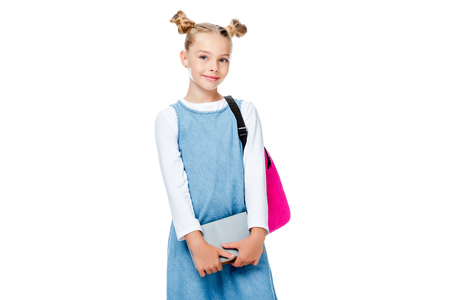 schoolchild with pink backpack holding books and looking at camera isolated on white