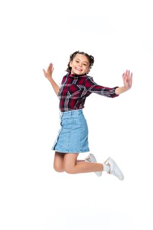 happy schoolchild jumping isolated on white