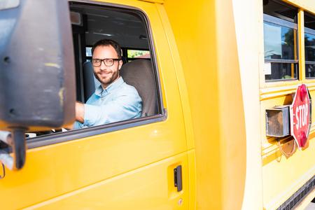 attractive happy school bus driver looking at camera