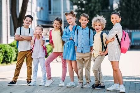 group of adorable pupils posing in school garden