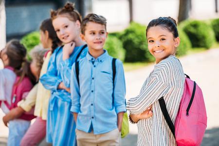 group of adorable schoolchildren spening time together after school