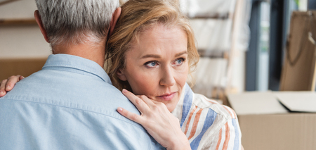 cropped shot of senior man hugging pensive wife while moving home Stockfoto