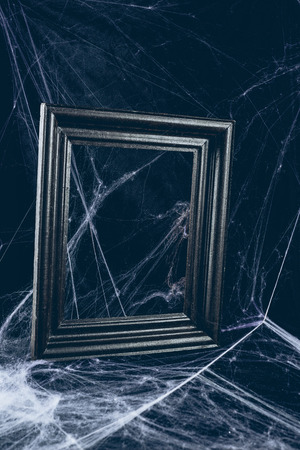 black frame in spider web, creepy halloween decor
