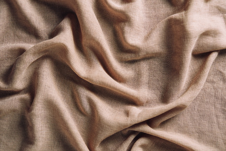 top view of crumpled beige cloth for background