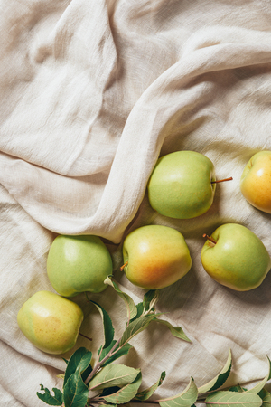 top view of green apples with apple tree leaves on sacking cloth Reklamní fotografie
