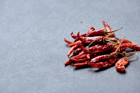 close up view of spicy chili peppers on grey tabletop 스톡 콘텐츠