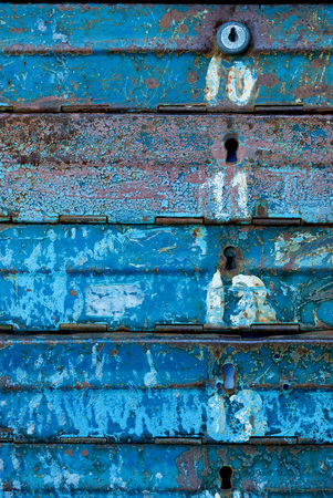 close up view of old blue mail boxes