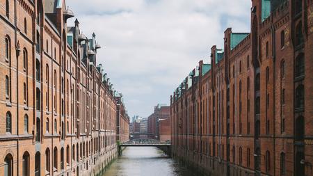 HAMBURG, GERMANY - 28 JUNE 2018: Elbe river, bridge and buildings at warehouse district in Hamburg, Germany Editorial
