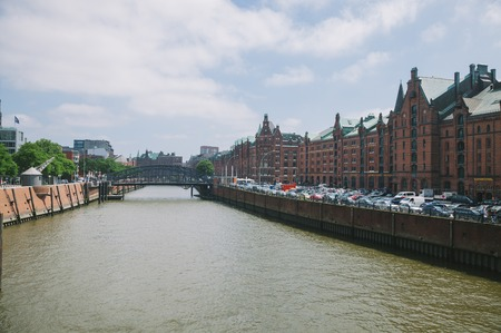 HAMBURG, GERMANY - 28 JUNE 2018: Elbe river and buildings at warehouse district