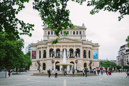 FRANKFURT, GERMANY - 28 JUNE 2018: tourists walking on opera square near opera house