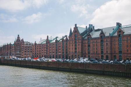 HAMBURG, GERMANY - 28 JUNE 2018: Elbe river, buildings and cars at warehouse district