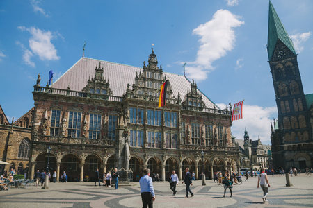 BREMEN, GERMANY - 28 JUNE 2018: tourists walking near Bremen City Hall
