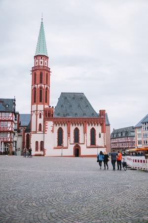 FRANKFURT, GERMANY - 28 JUNE 2018: people walking on square near Old St Nicholas Church Editorial
