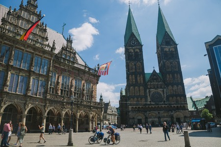 BREMEN, GERMANY - 28 JUNE 2018: people walking on square near Bremen City Hall