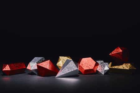 red, silver and golden glittering minerals on black background Stock Photo