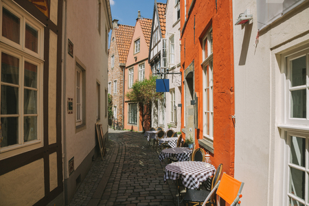 street with summer restaurant and buildings during daytime in Bonn, Germany