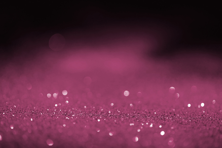 abstract blurred pink glitter on dark background Stock Photo - 108647344