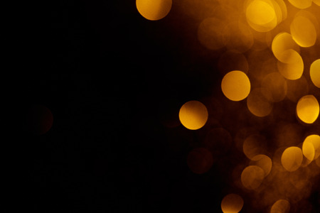abstract dark background with beautiful gold bokeh and copy space Stock Photo - 108647376