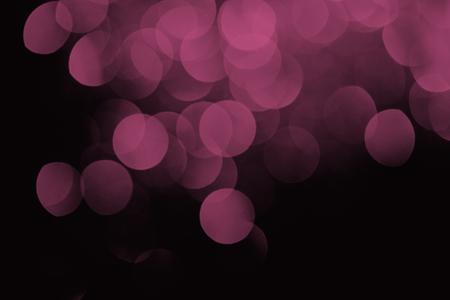festive purple bokeh on black background