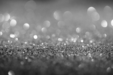 abstract background with glowing silver glitter and bokeh Stock Photo - 108647482