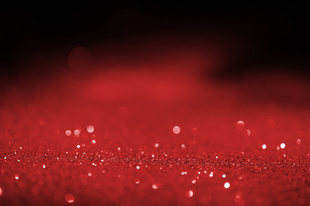 abstract blurred red glitter on dark background Stock Photo - 108647515