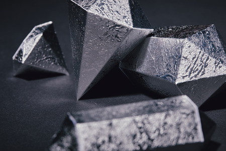 close-up view of beautiful shiny silver pieces on black