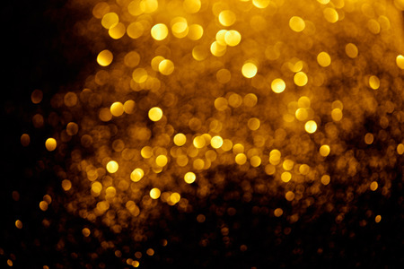 abstract background with blurred glowing golden glitter Stock Photo