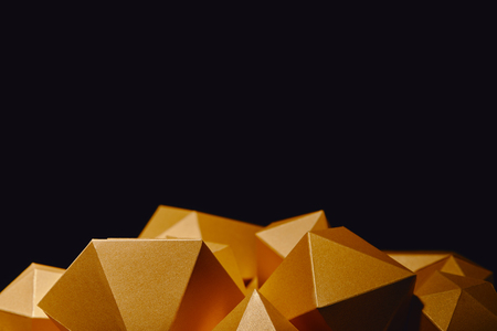 close-up view of faceted golden nuggets isolated on black background Stockfoto