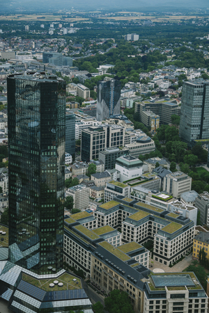 aerial view of cityscape with skyscrapers and buildings in Frankfurt, Germany