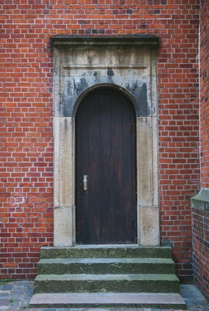 wooden door of brick building in Hamburg, Germany