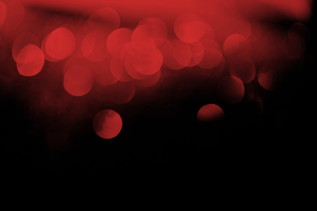 festive red bokeh on black background Stock Photo - 108648258