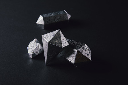 high angle view of shiny faceted silver pieces on black Stockfoto