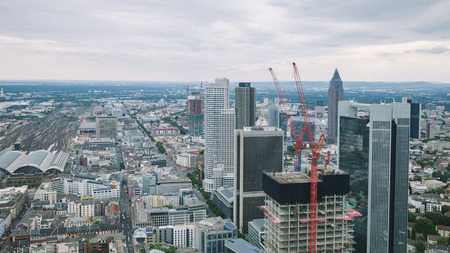 aerial view of cityscape with skyscrapers and buildings near crane in Frankfurt, Germany Stock Photo