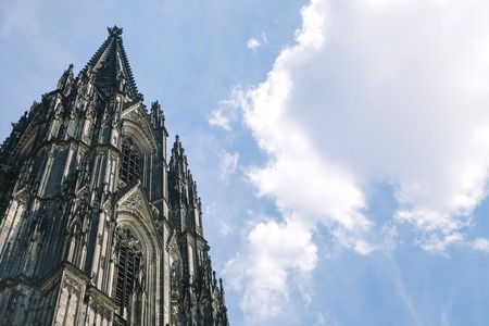 low angle view of Kolner Dom (Cologne cathedral) against cloudy blue sky in Cologne, Germany