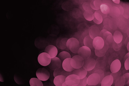 purple bokeh on black background for holiday Stock Photo