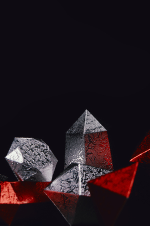 red and silver glittering gems on black background