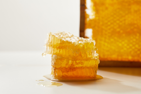 close up view of stack of beeswax on white surface Stok Fotoğraf - 108649243