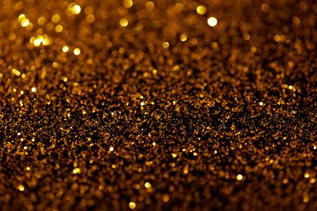 abstract dark golden glitter texture Stock Photo