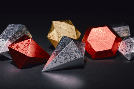 close-up view of shiny golden, red and silver minerals on black