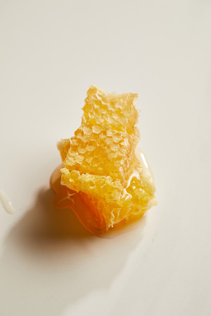 close up view of natural beeswax on white background 写真素材