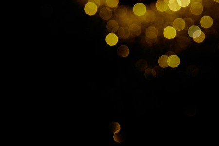 abstract dark background with gold bokeh