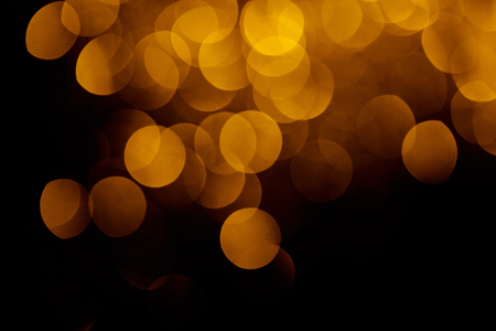 gold festive bokeh on black background for holiday Stock Photo