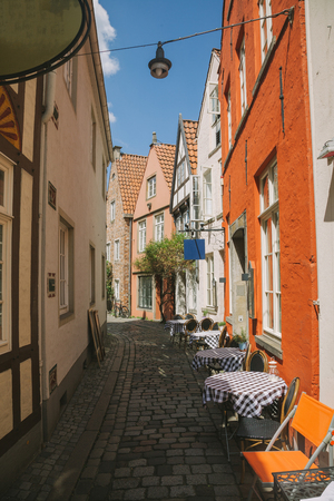 summer cafe and buildings at urban street in Bonn, Germany