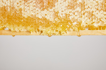 close up view of organic beeswax on grey background Reklamní fotografie