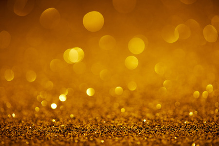 abstract golden glitter with bokeh on background Stock Photo