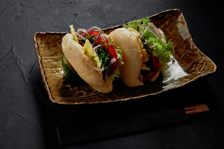 close-up view of delicious spicy pork buns with vegetables on plate Stok Fotoğraf