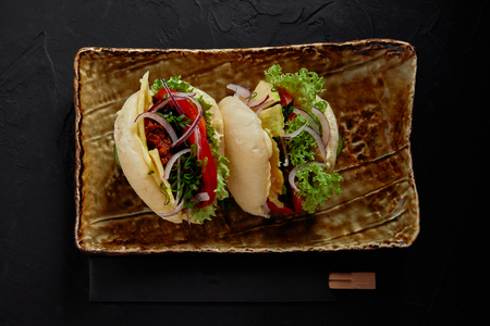 top view of delicious braised spicy pork buns with vegetables on plate Stok Fotoğraf