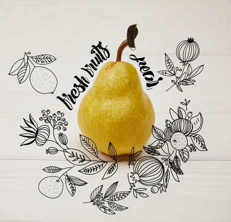 one juicy pear on wooden background with floral illustration Fresh fruits - pear lettering Stock Photo