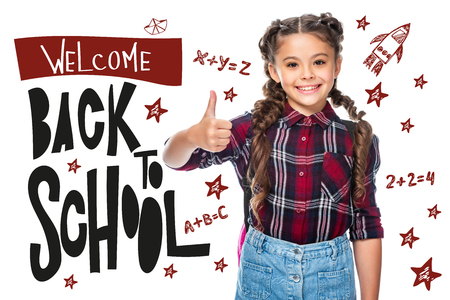 smiling schoolchild showing thumb up isolated on white, with welcome back to school lettering