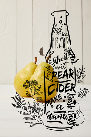 two yellow organic pears on wooden background with illustration of cider bottle and flowers Stock Photo